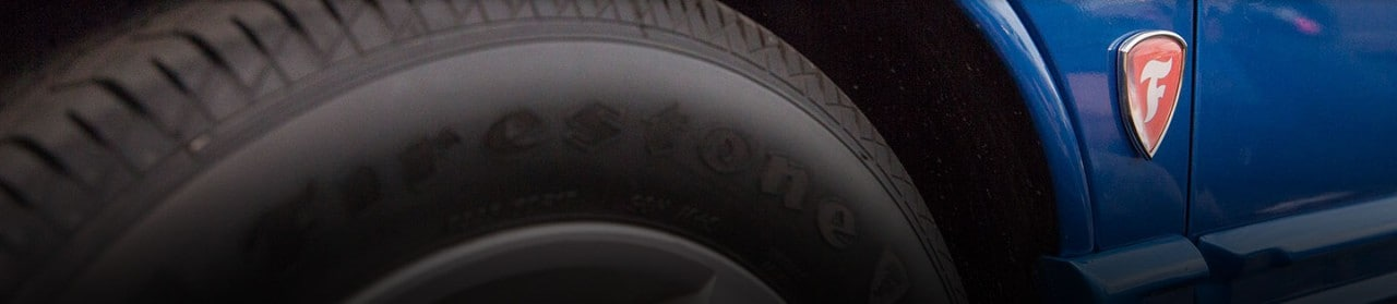 Close up of firestone tire on car